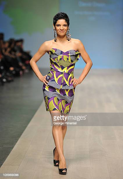 CBC correspondent Anne Marie Mediwake walks the runway wearing David Dixon spring 2011 collection at Heritage Court Exhibition Place on October 22...