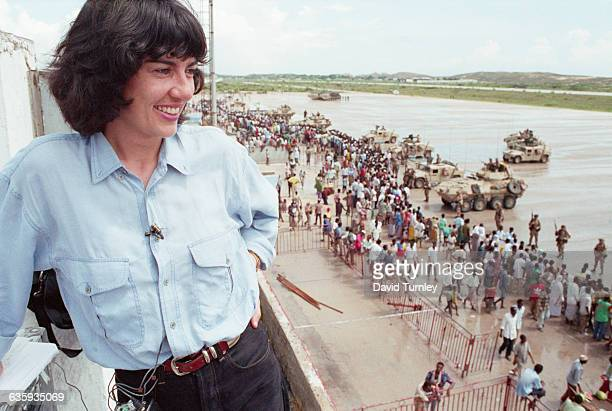 Correspondent Christiane Amanpour covers the US-led peacekeeping operation in Mogadishu. From a tower she watches and smiles at Somali civilians...