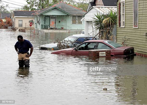 CNN correspondent Jeff Koinange pauses while taping a segment on the flooding in the Lower Ninth Ward September 24 2005 in New Orleans Louisiana The...