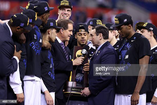 CBS correspondent Jim Nantz speaks to head coach Mike Krzyzewski of the Duke Blue Devils as his team looks on after defeating the Wisconsin Badgers...