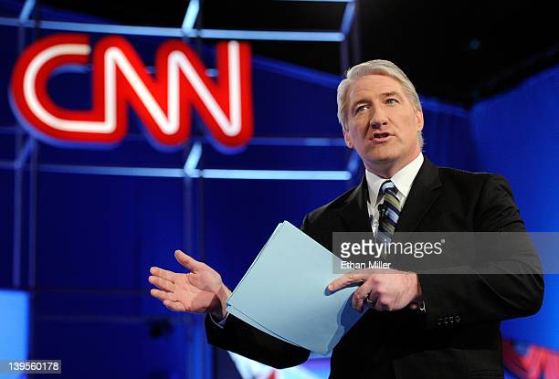 Correspondent John King talks to the audience before moderating a debate sponsored by CNN and the Republican Party of Arizona at the Mesa Arts Center...