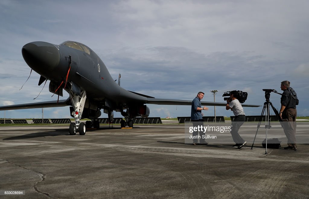 CNN correspondent Martin Savidge (L) reports in front of a U.S. Air Force Rockwell B-1B Lancer that sits on the tarmac at Andersen Air Force base on August 17, 2017 in Yigo, Guam. The American territory of Guam remains on high alert as a showdown between the U.S. and North Korea continues. North Korea has said that it is planning to launch four missiles near Guam by the middle of August. Guam home to about 7,000 American troops and 160,000 residents.