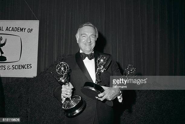 CBSTV correspondent Walter Cronkite holds the three Emmys he was presented by the National Academy of Television Arts and Sciences The Columbia...