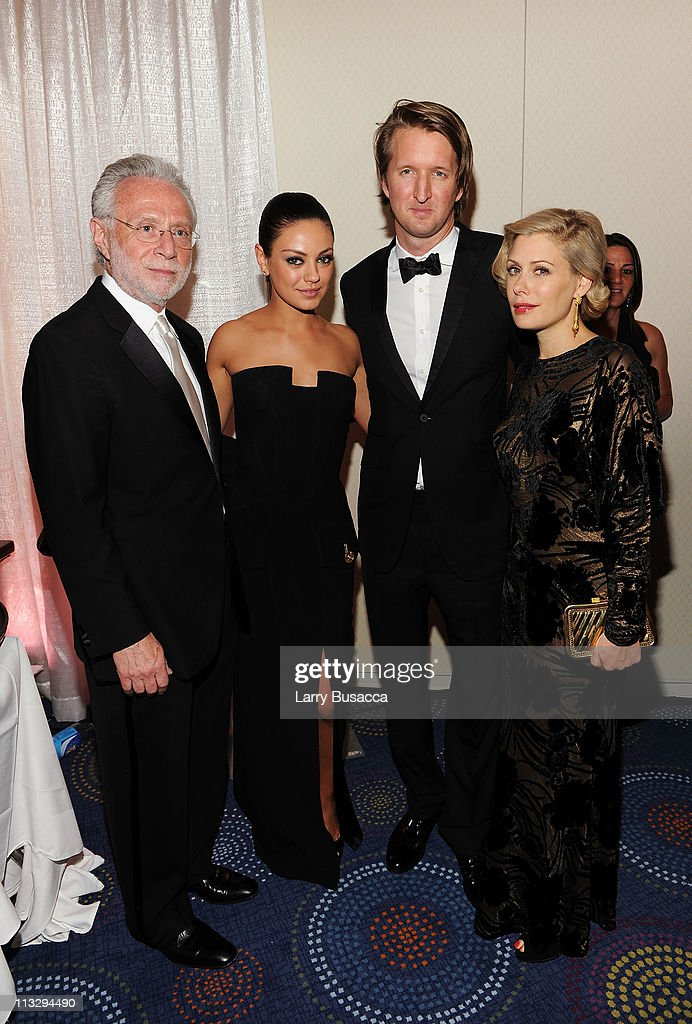 CNN Correspondent Wolf Blitzer, actress Mila Kunis, director Tom Hooper and designer Tara Subkoff attend the TIME/CNN/People/Fortune White House Correspondents' dinner cocktail party at the Washington Hilton on April 30, 2011 in Washington, DC.