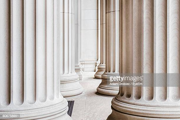 corridor amidst columns - column stock pictures, royalty-free photos & images