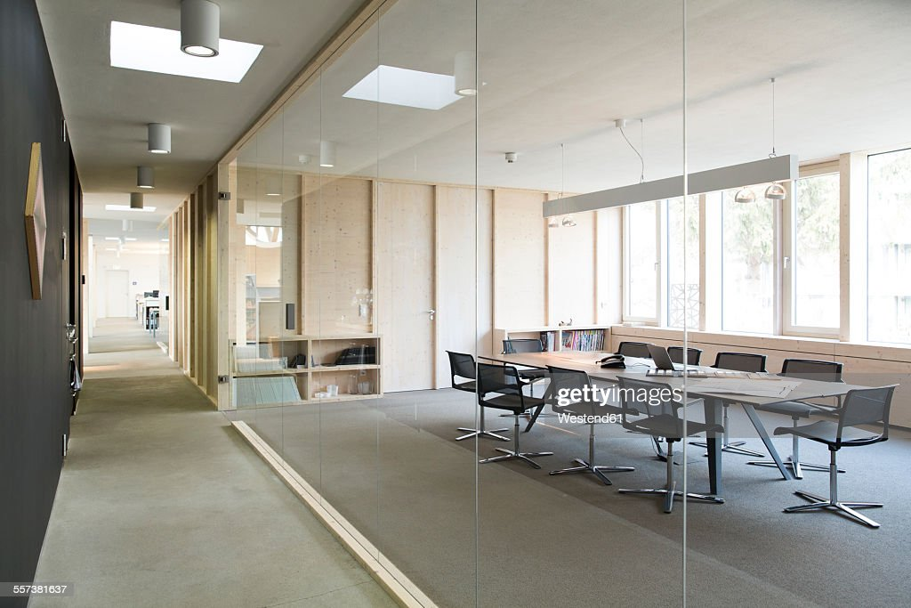 Corridor and modern conference room separated by glass pane : Stock Photo