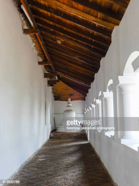 corridor  connecting the caves at the dambulla rock cave temples, sri lanka - stupa stock pictures, royalty-free photos & images