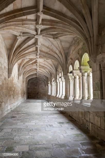 corridor in cloister of santo estevo monastery - cloister stock pictures, royalty-free photos & images