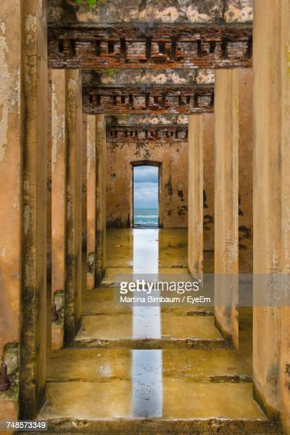 corridor of abandoned building - column stock pictures, royalty-free photos & images
