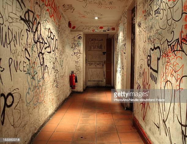 Corridor walls covered with graffiti