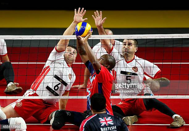 Corrie Mapp of Great Britain attempts to smash under pressure from Manuchar Nakishashvili and Paata Jibuti of Georgia during the semi final of the...