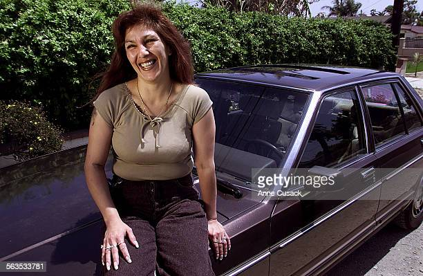 Corrina Arenas from El Rio sits on her 1983 Datsun Maxima which she purchased two and a half years ago with the help of a Non Profit group called...