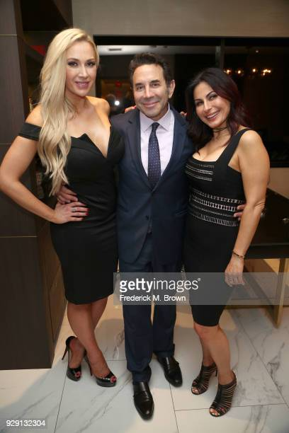 Corrine Conley Dr Paul Nassif and Ana Martin arrive for Dr Paul Nassif unveils his new medical spa with grand opening and ribbon cutting ceremony on...