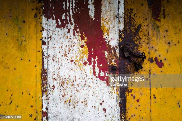Corroded door into an engine room is seen on the deck of an old gold dredge anchored in the Atrato river on October 12, 2019 in Quibdó, Colombia. A...