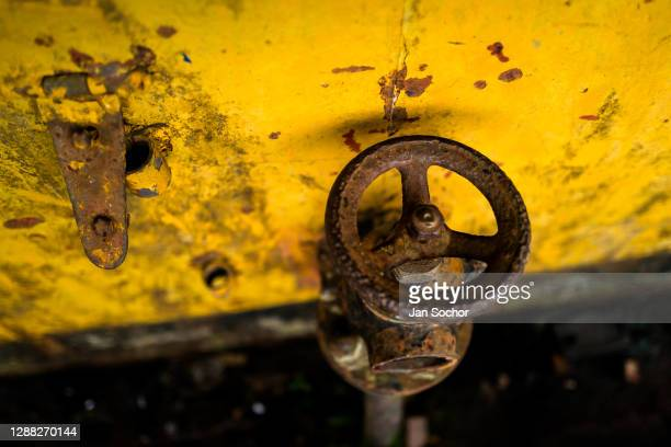 Corroded valve on the water pipe is seen on the deck of an old gold dredge anchored in the Atrato river on October 12, 2019 in Quibdó, Colombia. A...