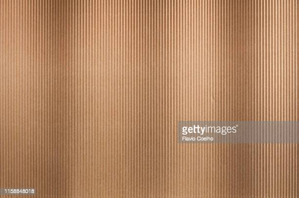corrugated cardboard paper sheet - grooved stock pictures, royalty-free photos & images