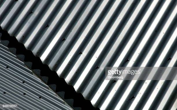 A corrugated iron roof shines in the sun in Sydney Australia on Monday Sept 24 2007 Cia Vale do Rio Doce Rio Tinto Group and BHP Billiton Ltd the...