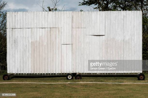 corrugated iron structure with wheels on field - corrugated iron stock photos and pictures
