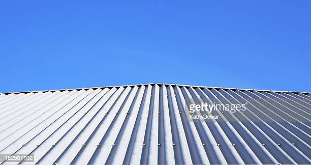 corrugated metal roof and blue sky - corrugated iron stock photos and pictures