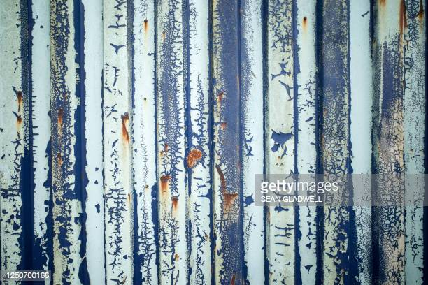 corrugated steel peeling paint - heavy metal stock pictures, royalty-free photos & images