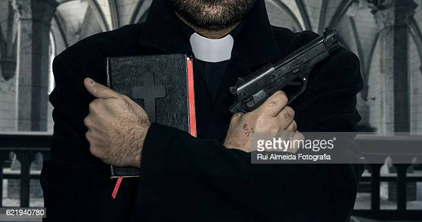 corruption in the church, bibles and weapons - priest stock pictures, royalty-free photos & images