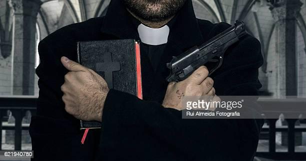 corruption in the church, bibles and weapons - sacerdote fotografías e imágenes de stock