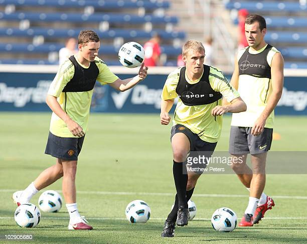 Corry Evans, Darren Fletcher and Darron Gibson of Manchester United in action during a First Team Training Session as part of their pre-season tour...