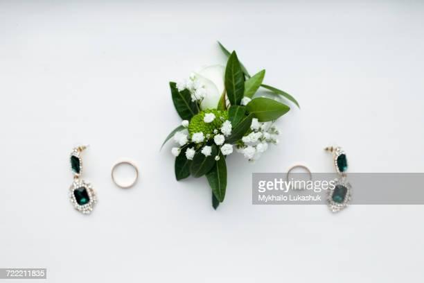 Corsage, earrings and wedding rings