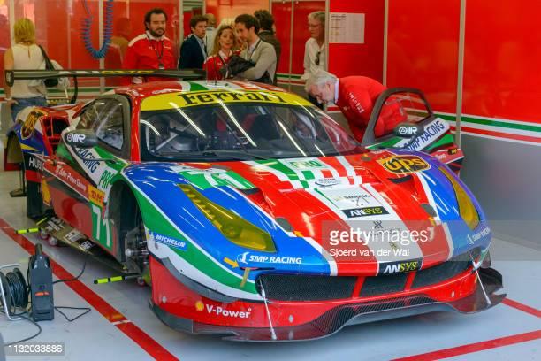 Corse Ferrari 488 GTE race car of Sam BirdandDavide Rigonin the No 71AF CorseFerrari in the pit box with mechanics preparing the car for the 6...