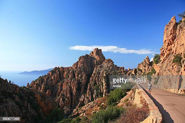 Corsica Calanques de Piana in the Gulf of Porto listed Unesco World Heritage Site Tourists on the coastal road