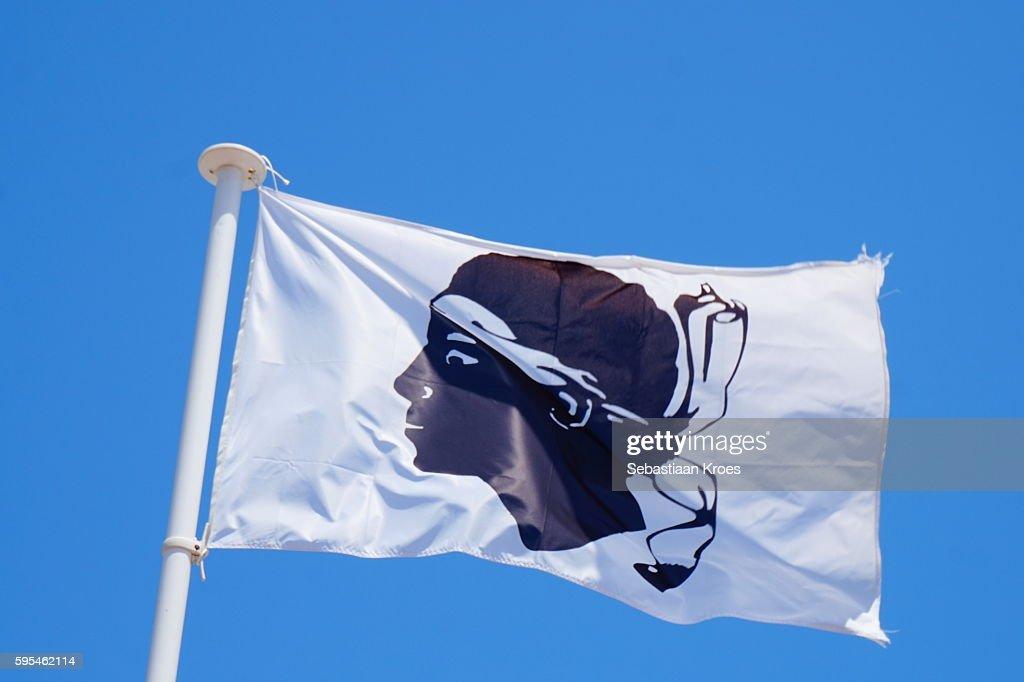 Corsican Flag in the Wind, Macinaggio, France : Stock Photo