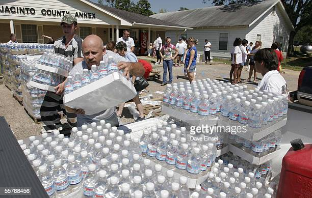 Cort Humes of the Camilla Volunteer Fire Department loads water into his truck at the San Jacinto County Annex September 25 2005 in Coldspring Texas...