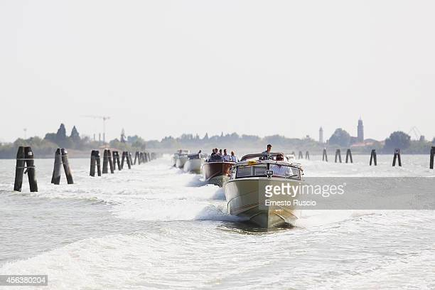 Cortege of photojournalists and bodyguard during the George Clooney And Amal Alamuddin Civil Wedding at Marco Polo Airport on September 29, 2014 in...