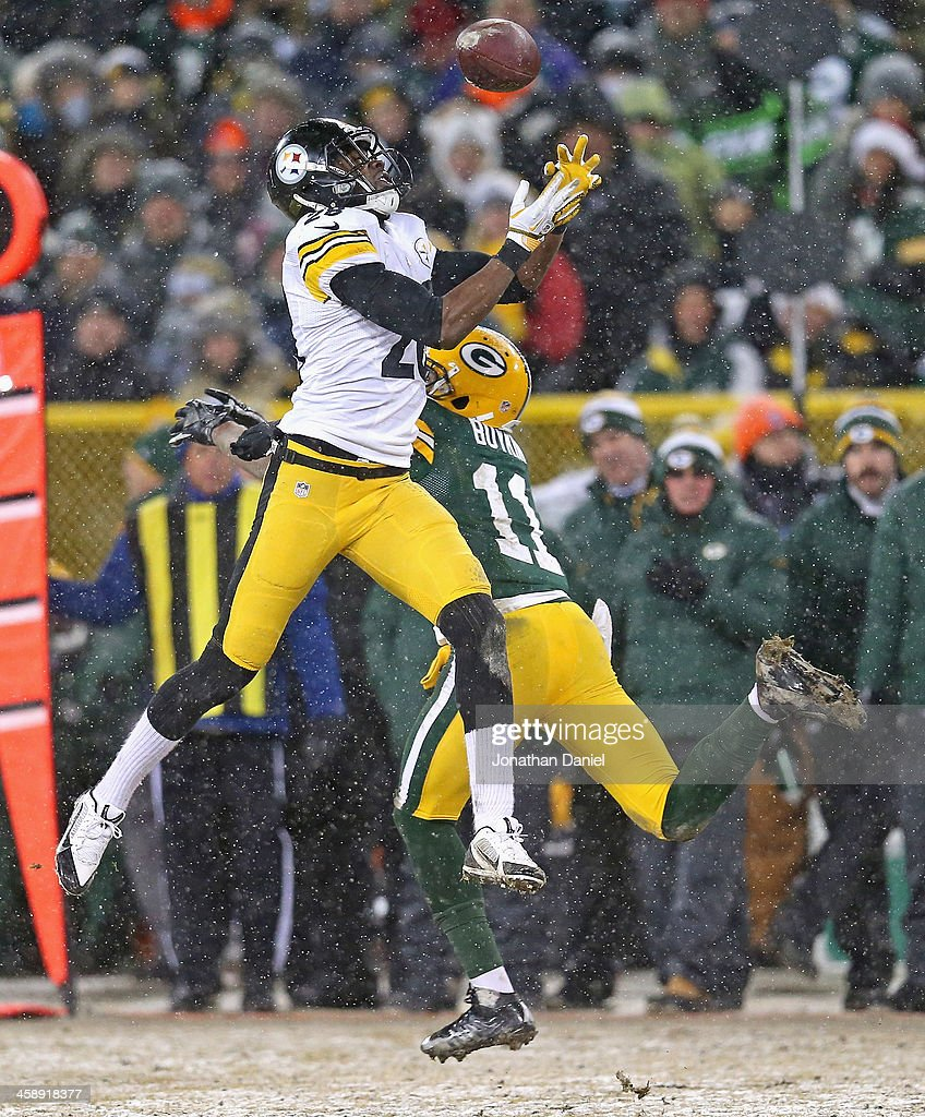 Cortez Allen #28 of the Pittsburgh Steelers intercepts a pass for a touchdown over Jarrett Boykin #11 of the Green Bay Packers at Lambeau Field on December 22, 2013 in Green Bay, Wisconsin. The Steelers defeated the Packers 38-31.