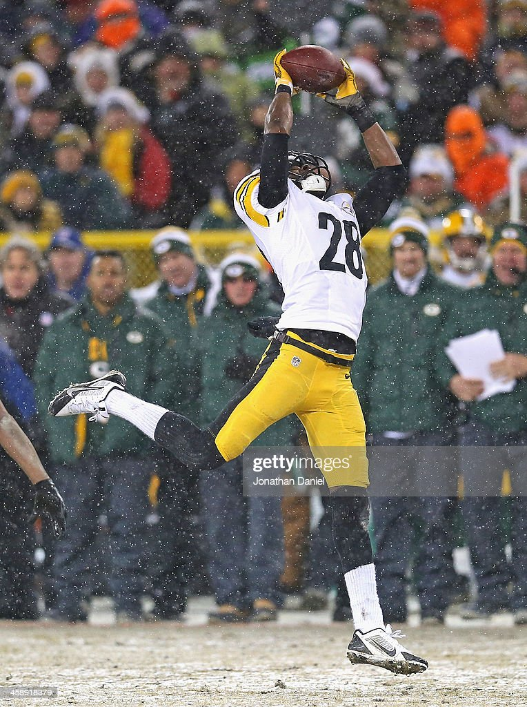 Cortez Allen #28 of the Pittsburgh Steelers intercepts a pass for a touchdown against the Green Bay Packers at Lambeau Field on December 22, 2013 in Green Bay, Wisconsin. The Steelers defeated the Packers 38-31.