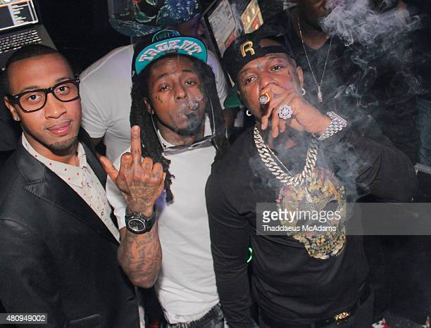 Cortez Bryant Lil Wayne and Birdman ring in the New Year on December 31 2014 in Miami Florida