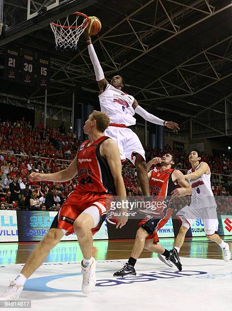 Cortez Groves of the 36'ers lays up over Shawn Redhage of the Wildcats during the round 13 NBL match between the Perth Wildcats and the Adelaide...