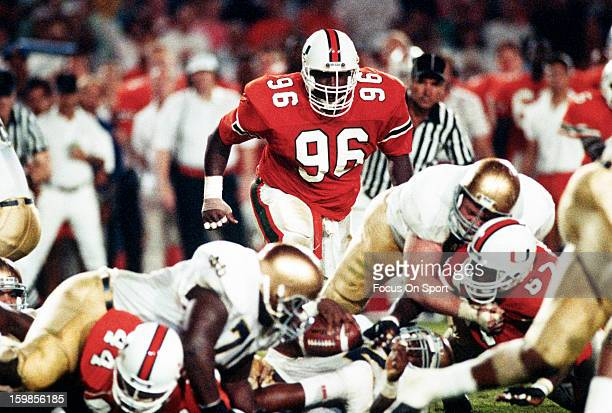 Cortez Kennedy of the Miami Hurricanes in action against Notre Dame Fighting Irish during an NCAA football game November 25 1989 at Joe Robbie...