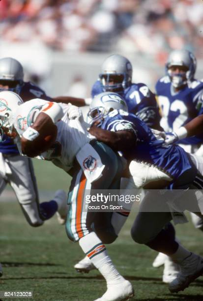 Cortez Kennedy of the Seattle Seahawks in action against the Miami Dolphins during an NFL football game December 16 1990 at Joe Robbie Stadium in...