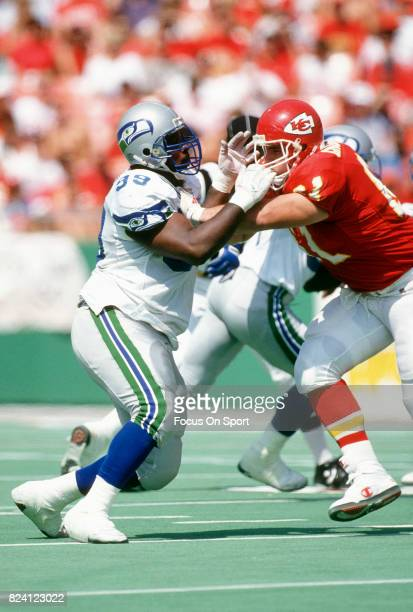 Cortez Kennedy of the Seattle Seahawks rushes up against Tim Grunhard of the Kansas City Chiefs during an NFL football game September 13 1992 at...