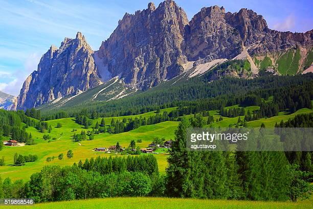 Cortina Alpine village meadows sunrise, Dolomites, Italian Tirol alps