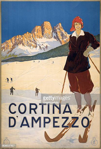 Cortina d'Ampezzo' travel poster with a woman in Italy on skis with ski slopes and mountains in the background c 1920 Print