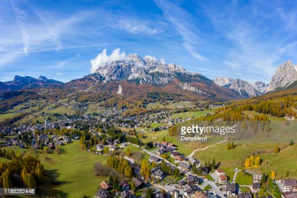 cortina d'ampezzo with pomagagnon mount in background, dolomites, italy, south tyrol. - veneto stock pictures, royalty-free photos & images
