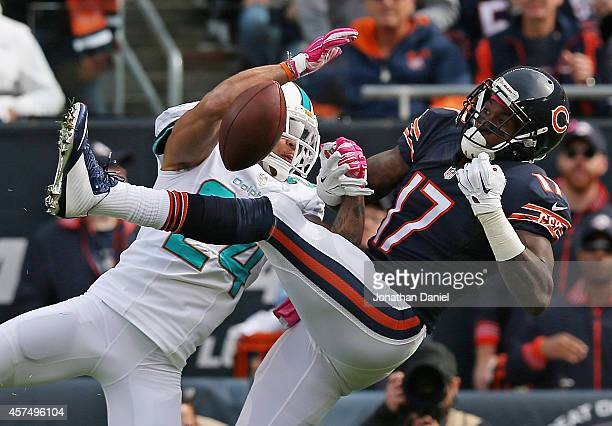 Cortland Finnegan of the Miami Dolphins breaks up a pass intended for Alshon Jeffery of the Chicago Bears at Soldier Field on October 19 2014 in...