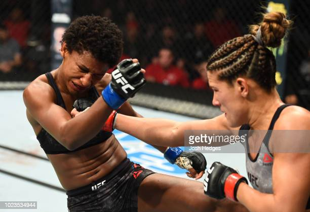 Cortney Casey punches Angela Hill in their womens strawweight fight during the UFC Fight Night event at Pinnacle Bank Arena on August 25 2018 in...