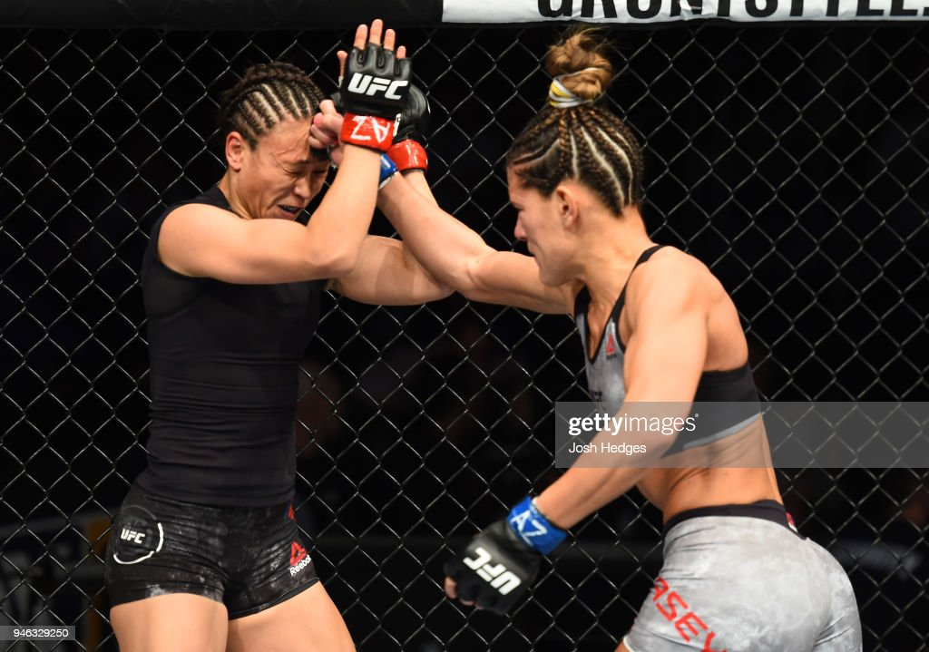 Cortney Casey punches Michelle Waterson in their womens strawweight fight during the UFC Fight Night event at the Gila Rivera Arena on April 14, 2018 in Glendale, Arizona.