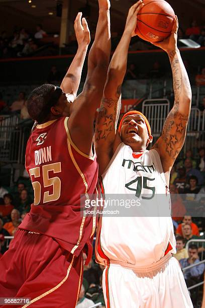 Cortney Dunn of the Boston College Eagles blocks the shot of Julian Gamble of the Miami Hurricanes on January 19 2010 at the BankUnited Center in...