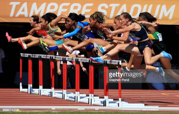 Cortney Jones of The USA and Sacha Alessandrini of France in action during heat 1 of the women's 100m hurdles semi finals on day five of The IAAF...
