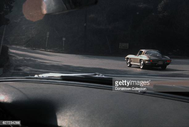 Corvette drives along Mulholland Drive in December 1963 in Los Angeles California
