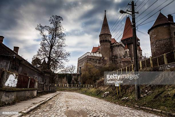 corvin castle and street in hunedoara, transylvania, romania - count dracula stock photos and pictures